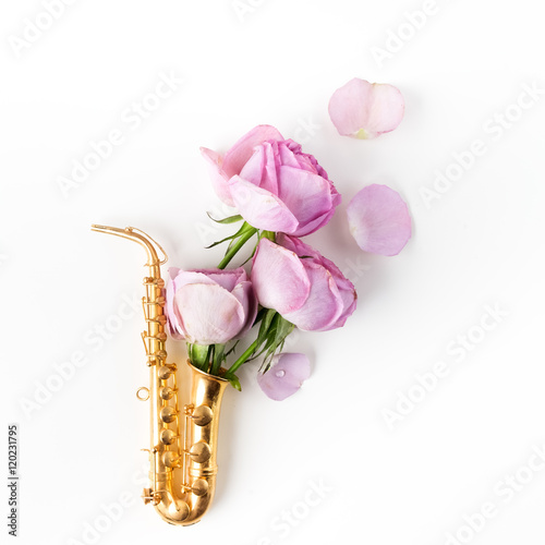 Poster Jazz Day. Saxophone with flowers. Flat lay, top view