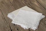Handkerchiefs.   Handkerchiefs with a decorative trim on a gray wooden background.