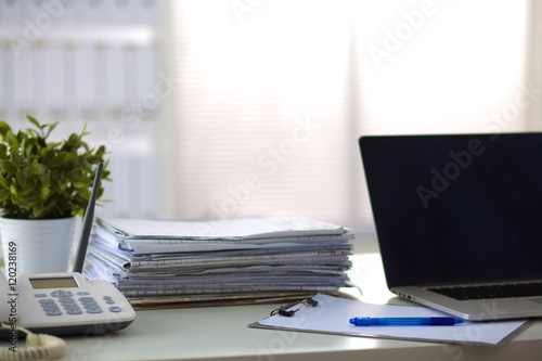 stack of papers on the desk with computer Poster