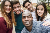 Multiracial group of friends taking selfie