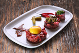 Steak tartare with capers and egg yolk. - 120245367
