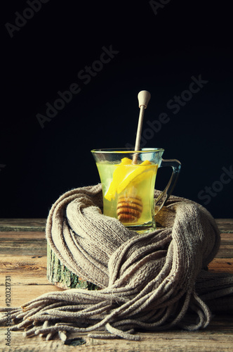 Poster Hot drink with honey and lemon wrapped in a scarf