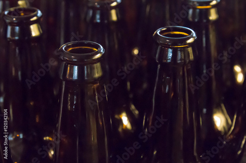 Poster Empty glass beer bottles, full frame