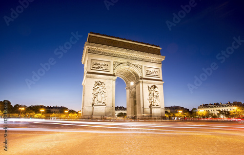 Wall mural Arc de triomphe in Paris at night, France