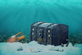 beautiful opened empty old wooden treasure chest submerged under - 120355322