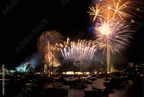 Fireworks over Sydney harbour Bridge and Opera House.