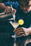 Barman making margarita cocktail