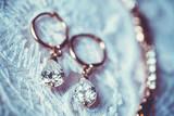 earrings on the white wedding dress