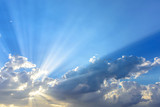 Fototapety Sun beams or light rays breaking through the clouds. Beautiful s