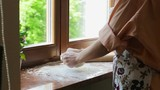 Girl chef kneads the dough for the pie