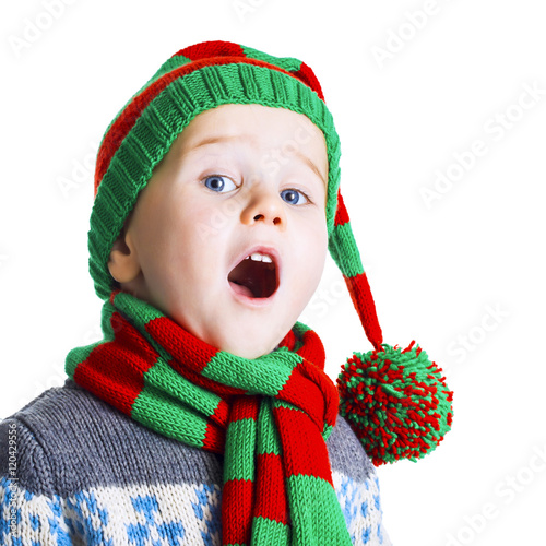 Christmas boy in knitted cloths sings a Christmas song