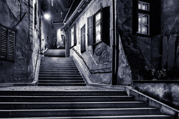 Moody monochrome view of Goldsmiths passage, in Sibiu, Romania, © mandritoiu