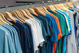 Many t-shirt hanging in a wardrobe