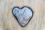 Heart of rock on a grunge wall