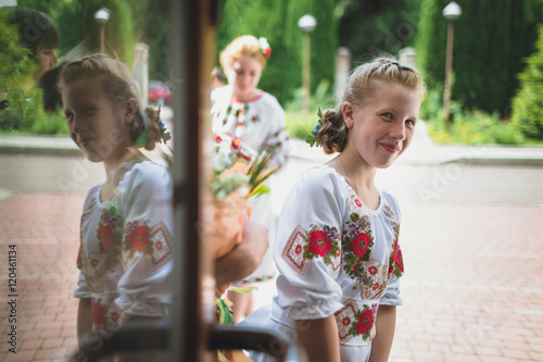 Valokuva young girl in embroidered shirts smiling