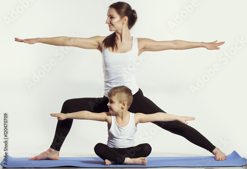 Keuken foto achterwand School de yoga mother and son doing yoga (sports exercises), have fun and spend a good time together . isolated on white. the concept of a healthy lifestyle