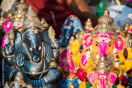 "Poster Colorful god named ""Ganapati"" ready to sell in the market at south India"
