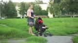 mother rolls the stroller