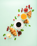 Fototapety breakfast time with croissants and coffee on green table