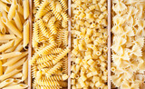 Various types of dry pasta of different shapes