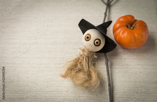 Poster Halloween concept, wooden ghost doll and dry wood stick on canvas background