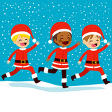 Cute little children wearing Santa Claus uniform running in snow winter night