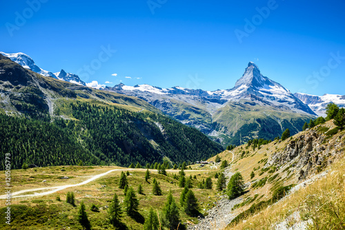 Matterhorn - small village with houses in beautiful landscape of Zermatt, Switze Poster