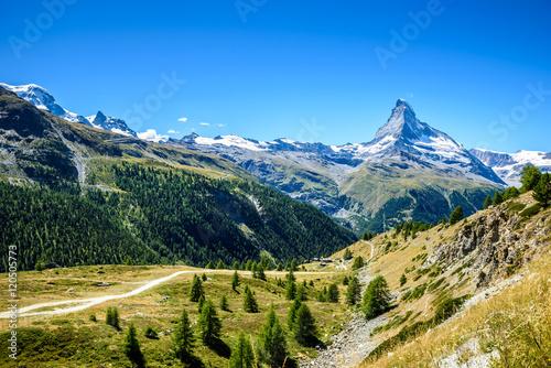 Poster Matterhorn - small village with houses in beautiful landscape of Zermatt, Switze