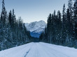 Snow covered road with mountains in winter, Emerald Lake, Yoho N