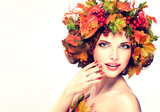 Autumn Beauty - woman fashion Makeup With Red and yellow autumn Leaves. Autumn wreath on girl head . Emotions and surprise on the face of the autumn girl 120421228,Moment in wedding