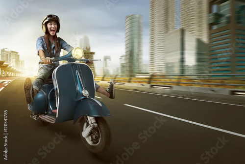 Poster Asian woman riding scooter and wearing helmet