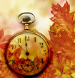 autumn leaves and clock