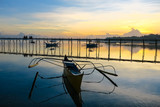 Fishing Boats docked in a reflective sunset