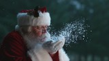 Santa Claus blowing snow from hands in slow motion, Phantom Flex 4K
