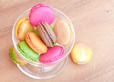 Colorful french sweets macarons on wooden table