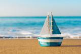 toy sailboat at the seashore - 120610324