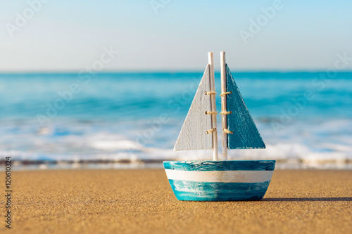 Fototapeta toy sailboat at the seashore
