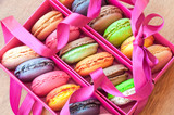 Colorful french sweets macarons in a pink box