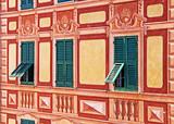 Liguria, Italy - painted house trompe-l'oeil detail of windows