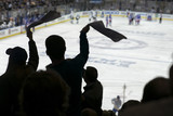 Fototapety Cheering crowd at a hockey game, Madison Square Garden, Manhattan, New York City.