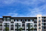 Modern apartment buildings on a sunny day with a blue sky - 120648789