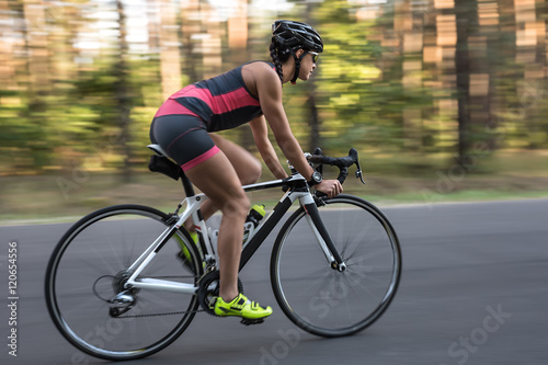 Athletic girl rides a bike