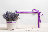 Bunch of lavender on a background of the empty form for congratulations on a wooden frame (Provence)