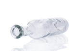 Empty vintage glass bottle on white background
