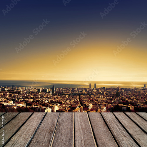 Sunset city background with wood panels perspective. Defocused u