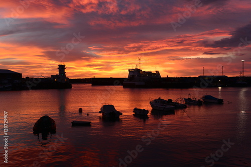 St.Helier harbour, Jersey, U.K. Dramatic Autumn coastal sunset.