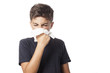 child blowing the nose has a cold