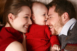Joyful young family with a baby