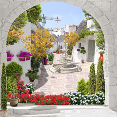 Street view with flowers and fountain, old city
