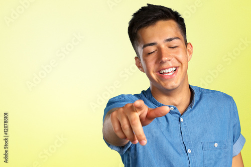 Plakat Portrait of a young man pointing his finger at you